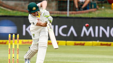 Cameron Bancroft drives down the ground