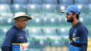 Chandika Hathurusingha speaks with Dinesh Chandimal during a practice session, Colombo, March 9, 2018