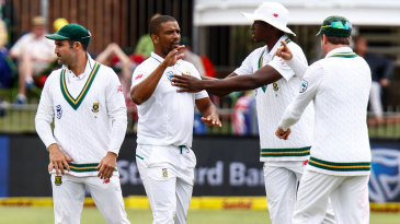 Vernon Philander is flanked by his team-mates after getting a wicket