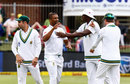 Vernon Philander is flanked by his team-mates after getting a wicket, South Africa v Australia, 2nd Test, 1st day, Port Elizabeth, March 9, 2018