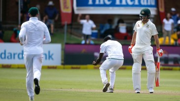 Kagiso Rabada celebrates in Mitchell Marsh's midst