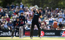 Mitchell Santner steps out to hit down the ground, New Zealand v England, 5th ODI, Christchurch, March 10, 2018