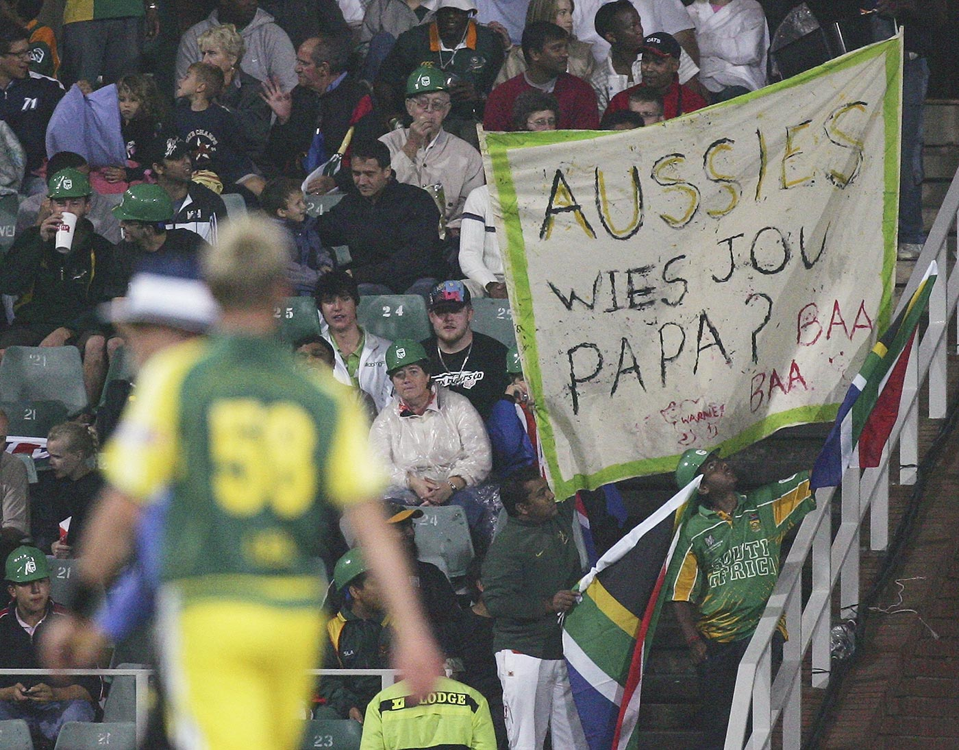 South African fans hold up a sign as Brett Lee walks back to his mark