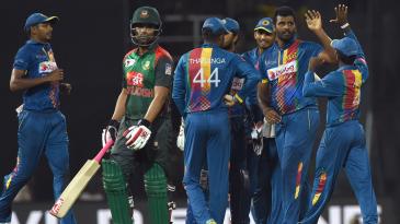 Thisara Perera celebrates the wicket of Tamim Iqbal