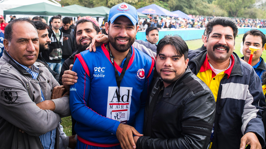 Babar Hayat poses with fans for photos while playing for Kowloon Cantons in a Hong Kong Blitz match