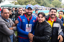 Babar Hayat poses with fans for photos while playing for Kowloon Cantons in a Hong Kong Blitz match, March 11, 2017