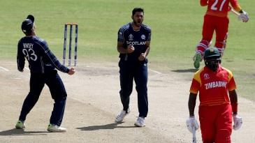 Safyaan Sharif celebrates Hamilton Masakadza's wicket