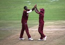 Jason Holder and Marlon Samuels get together to celebrate a wicket, West Indies v Afghanistan, World Cup Qualifiers, Super Six stage, March 15, 2018