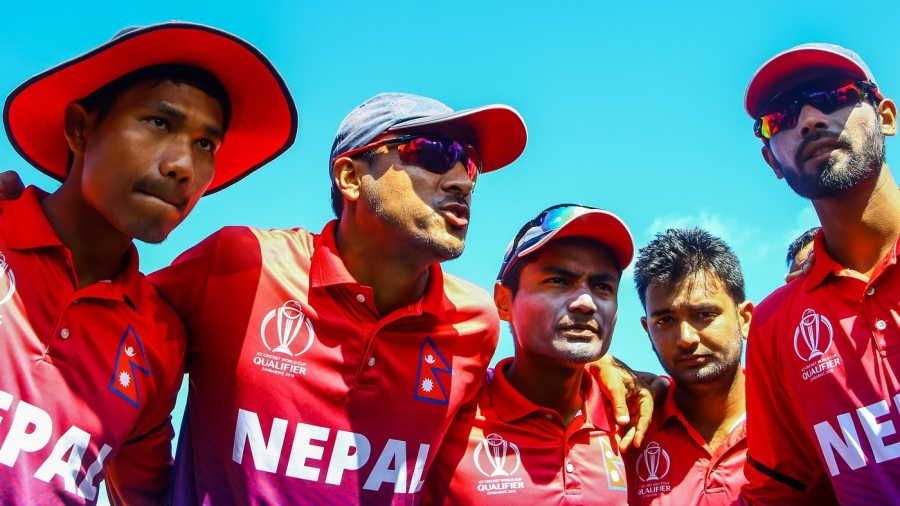 Paras Khadka leads the team huddle