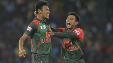 Mustafizur Rahman and Mehidy Hasan celebrate a wicket