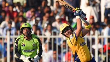 Kamran Akmal launches it down the ground