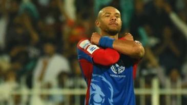 Tymal Mills celebrates a wicket