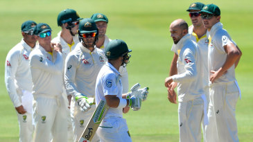 Nathan Lyon celebrates the wicket of Dean Elgar with his team-mates