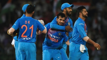 Yuzvendra Chahal is surrounded by team-mates after removing Soumya Sarkar