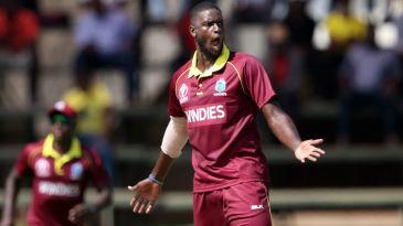 Jason Holder celebrates the wicket of Hamilton Masakadza