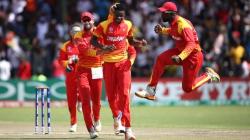 Zimbabwe's players are a delighted bunch after dismissing Chris Gayle