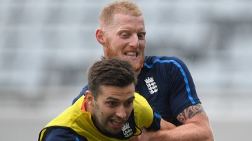Ben Stokes and Mark Wood engage in some football
