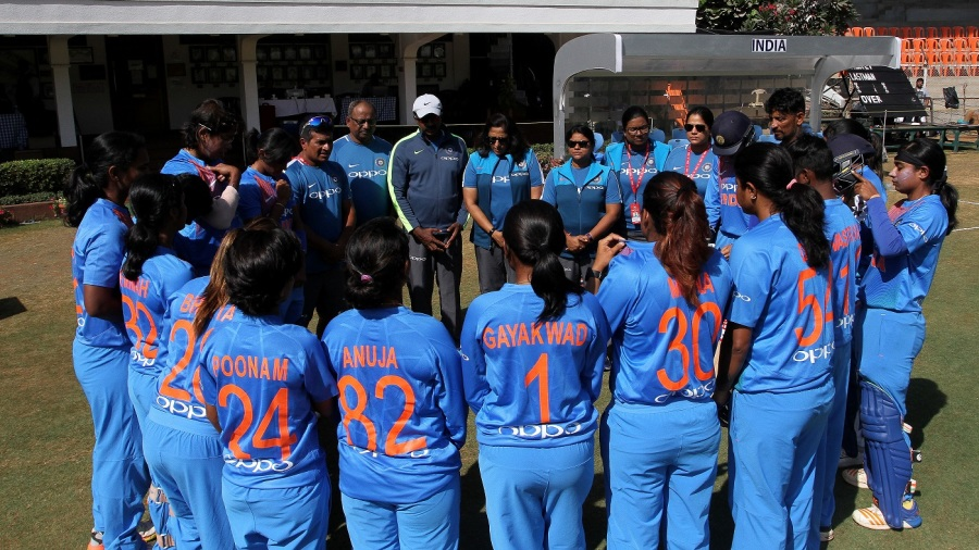 India players gather into a huddle before walking out to the field