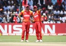 Graeme Cremer and Sikandar Raza discuss in the middle, Zimbabwe v UAE, World Cup qualifier, Super Sixes, Harare, March 22, 2018