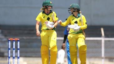 Meg Lanning and Rachel Haynes walk back after Australia's win