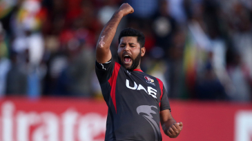 Mohammad Naveed exults after picking up a wicket