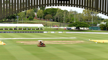A member of the ground staff works on the Allan Border Field outfield
