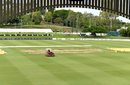 A member of the ground staff works on the Allan Border Field outfield, Queensland v Tasmania, Sheffield Shield 2017-18, final, Brisbane, 1st day, March 23, 2018