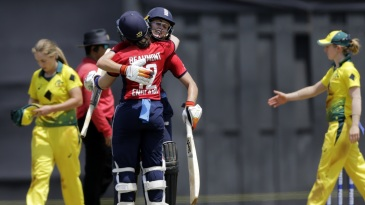Natalie Sciver and Tammy Beaumont celebrate after powering England to victory