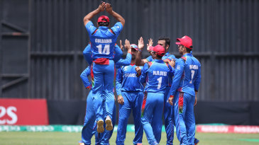 Afghanistan celebrate after getting a wicket