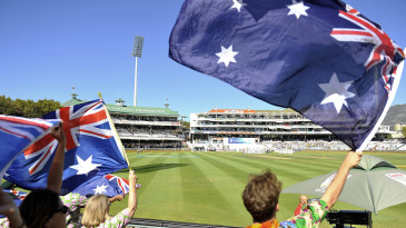 Spectators wave the Australian flag at Newlands