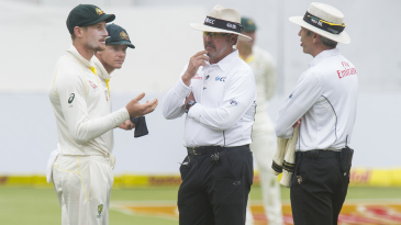 Cameron Bancroft shows a black piece of cloth to the umpires