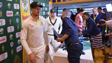 Cameron Bancroft and Steven Smith leave the press conference where they admitted to ball tampering