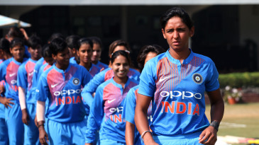 Harmanpreet Kaur leads her team out