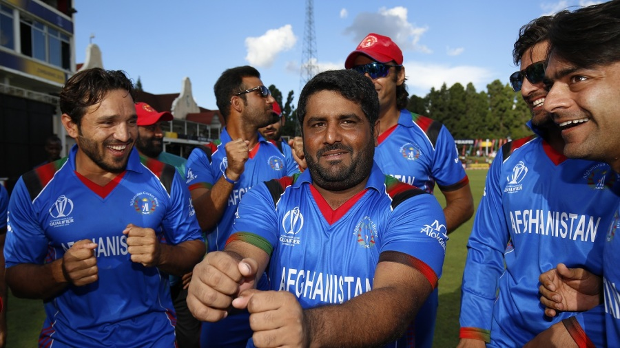 Afghanistan's players perform the <i>Champion</i> dance to celebrate their victory