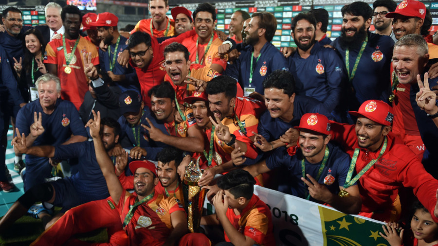 The Islamabad United team pose with the trophy