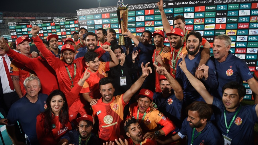 Islamabad United players and staff pose with the trophy