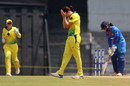 Megan Schutt can't believe her luck after dismissing Mithali Raj, India v Australia, Tri-Nation Women's T20 Series, Mumbai, March 26, 2018