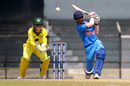 Pooja Vastrakar sends the ball down the ground, India v Australia, Tri-Nation Women's T20 Series, Mumbai, March 26, 2018