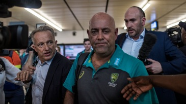 Journalists surround Darren Lehmann following his arrival in Johannesburg