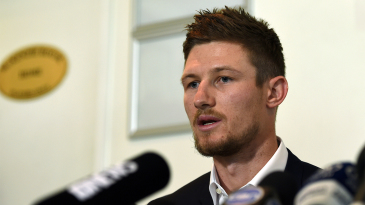 Cameron Bancroft speaks to the media after returning to Australia
