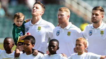 Morne Morkel, with his son, during his last national anthem as a South Africa player