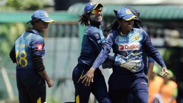 The Sri Lanka players celebrate a wicket