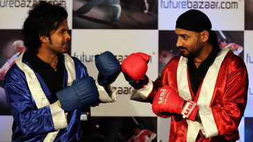 Sreesanth and Harbhajan Singh pose with boxing gloves at a promotional event in Mumbai