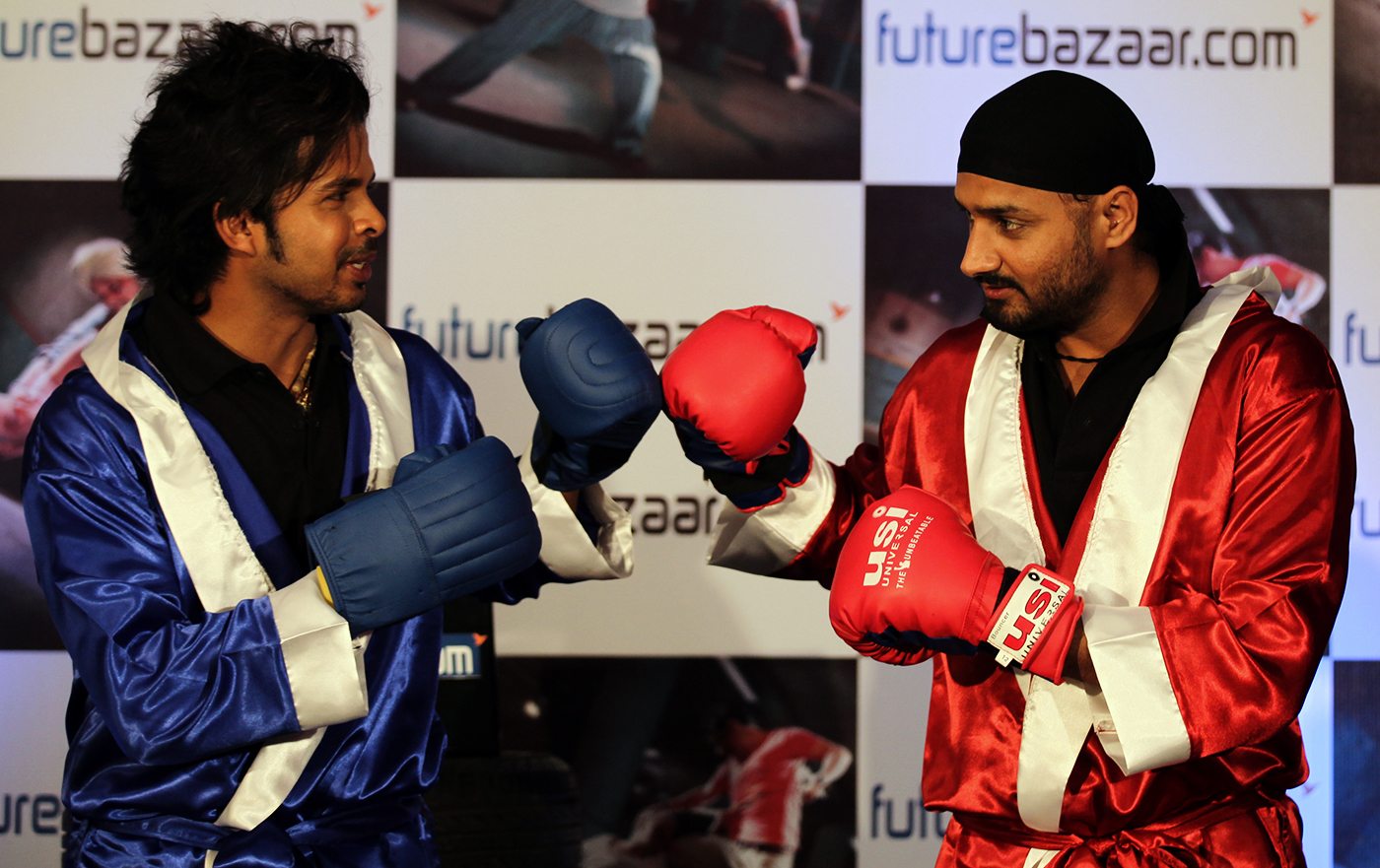 Gloves on: Harbhajan Singh and Sreesanth at a promotional event in 2010 that riffed on the Slapgate incident