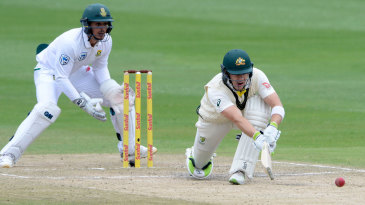 Tim Paine gets down for the paddle sweep