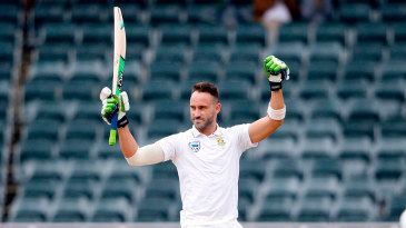 Faf du Plessis raises his arms to celebrate his century