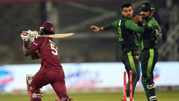 Shadab Khan and Sarfraz Ahmed celebrate a wicket