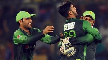 Shadab Khan celebrates the wicket of Marlon Samuels
