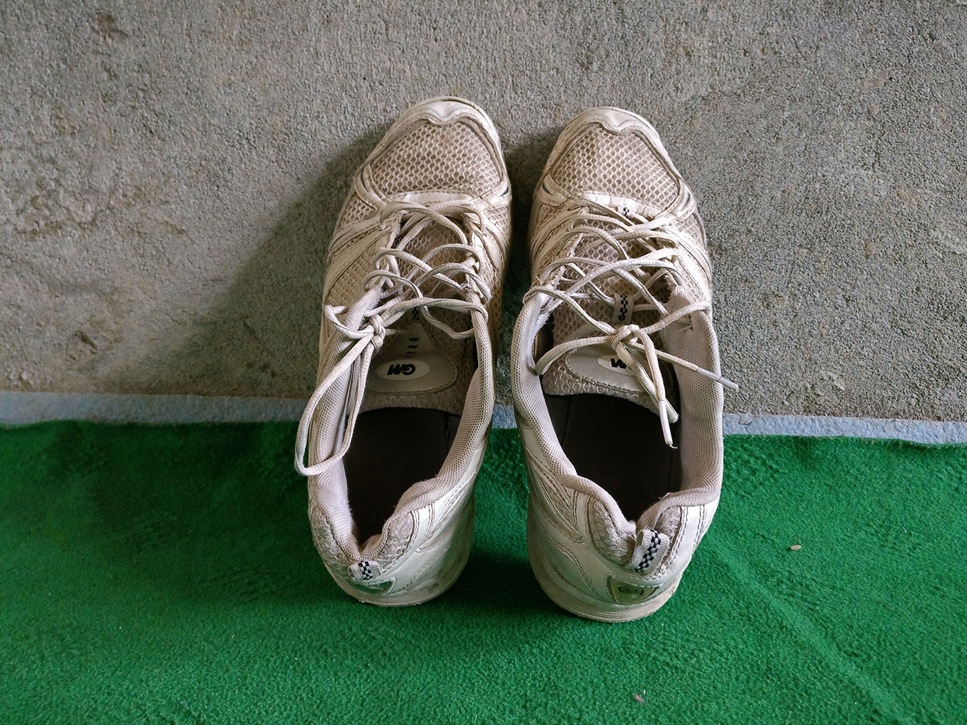 Manzoor's first pair of cricket shoes, gifted to him by Samiullah Beigh