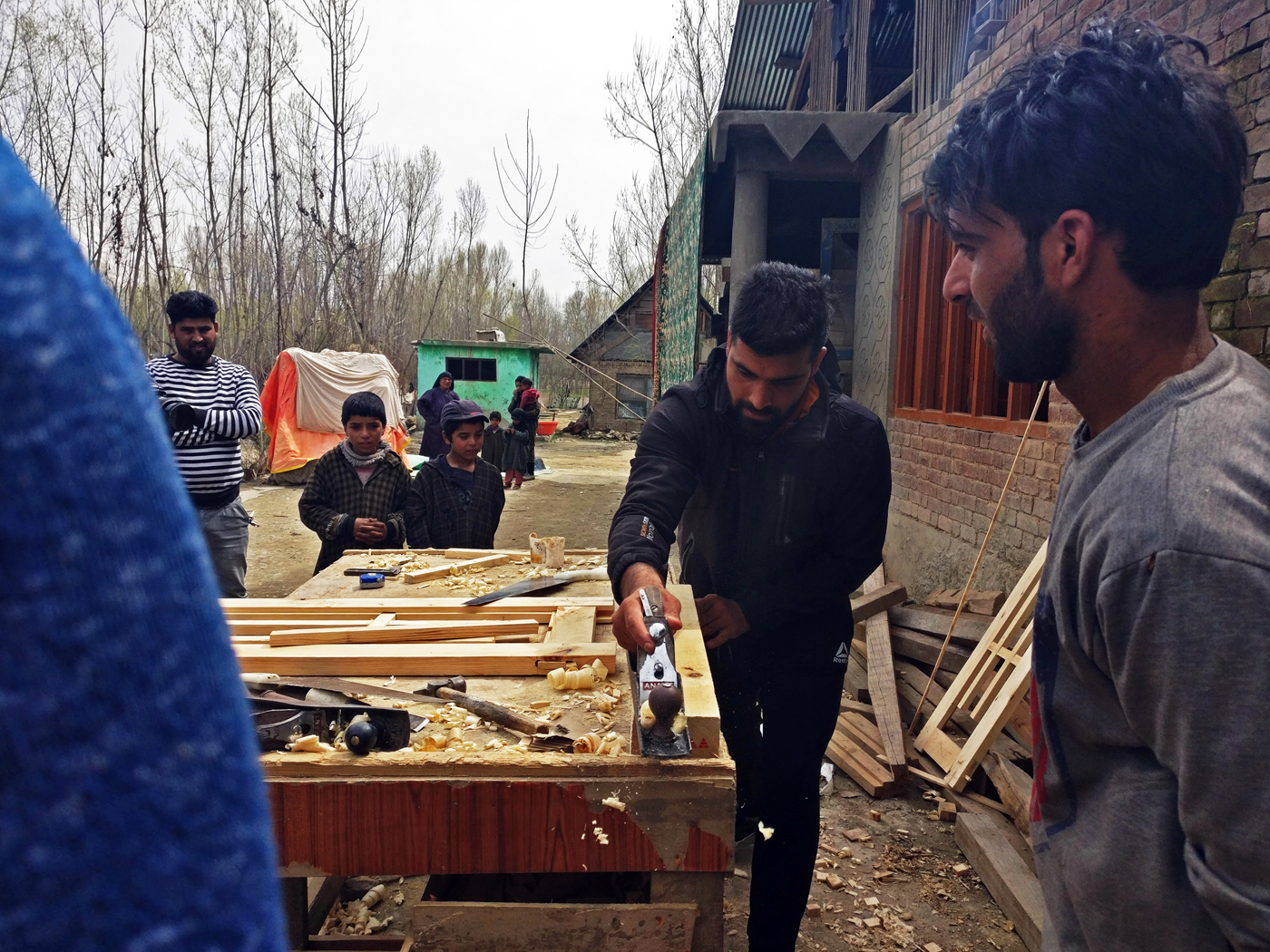 One of the many jobs Dar juggled to support his family was working at the local wood shop